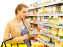FDA-Reading-Food-Label-Woman-Grocery-Store-Nutrition-Label-Changes